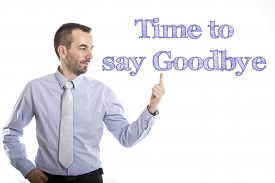 stock photo of say goodbye  - Time to say goodbye Young businessman with small beard touching text - JPG
