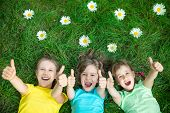 Group Of Happy Children Playing Outdoors poster