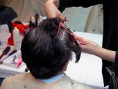 image of hair cutting  - two hands cutting hair in an old women had - JPG