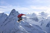Snowboard rider jumping on mountains. Extreme snowboard freeride sport. poster
