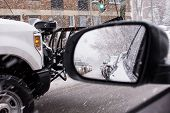 Winter Snow Storm Driving In Snow  With Traffic In Rear View Mirror And Snow Plow Driving On Street  poster