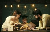 Homeschooling Concept. Father And Mother Reading Books, Teaching Their Son, Chalkboard On Background poster