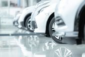 Cars For Sale, Automotive Industry, Cars Dealership Parking Lot. Rows Of Brand New Vehicles Awaiting poster