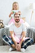 Adorable Little Daughter In Pink Tutu Skirt Doing Hairstyle To Happy Father With Red Lipstick poster