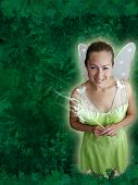 foto of tinkerbell  - A pretty fairy princess with fairy wings and a magic wand with a spring green background - JPG