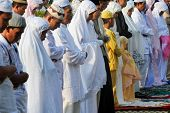 JAKARTA, INDONESIA - SEPTEMBER 20 : Muslims pray outside a mosque in Jakarta on Hari Raya, the end o