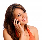Happy, smiling, fun brunette girl using cell phone and looking at camera
