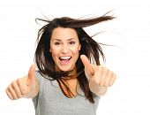 picture of windswept  - Pretty woman is jubilant with windswept hair  and thumbs up - JPG