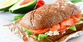 Sandwich With Avocado And Salmon On A Light Background, Green Onions And Gluten-free Grain Bread, Ra poster