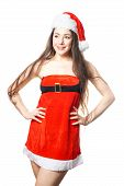 Beautiful Young Woman Dressed As Miss Santa Is Sexy Christmas Costume - Red Dress And Santa Claus Ha poster