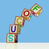 pic of slip hazard  - Wooden Blocks Spelling Focus Falling Over As Symbol for Lack Of Concentration - JPG