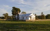 picture of farm-house  - An old house on the prairie in late afternoon light - JPG