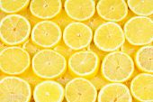 A Slices Of Fresh Juicy Yellow Lemons.  Texture Background, Pattern. poster