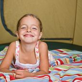 Girl laying in tent