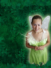 stock photo of tinkerbell  - A pretty fairy princess with fairy wings and a magic wand with a spring green background - JPG
