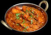 Indian chicken tikka jalfrezi curry in balti dish