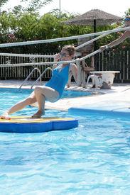 stock photo of tarzan  - Teen is in tarzan pool Water Park Rhodes - JPG