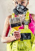 picture of respiration  - Female construction worker wearing respirator holding paint brush - JPG