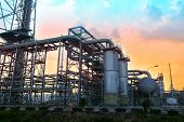 stock photo of greenpeace  - Oil refinery plant  with beautiful sky daytime - JPG