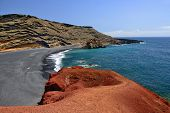 image of lagos  - Lanzarote black sandy beach in gulf of El Golfo Atlantic ocean near Lago de los Clicos in Canary Islands - JPG