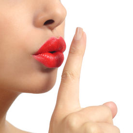stock photo of shhh  - Close up of a woman lips with finger asking for silence isolated on a white background - JPG