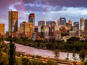 stock photo of bowing  - Calgary skyline at night with Bow River - JPG