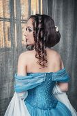 image of pompous  - Portrait of young beautiful medieval woman in blue dress - JPG