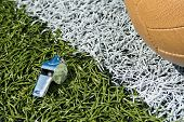 image of offside  - Whistle and soccer ball on a soccer field - JPG