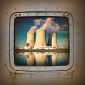 stock photo of nuclear disaster  - Nuclear power plant on the coast wiew from steel window - JPG