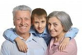 image of grandparent child  - Happy Grandparents with grandson on white background - JPG