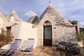 picture of conic  - Trulli houses with conical roofs in Alberobello - JPG