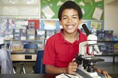 picture of microscope slide  - Boy in science class with microscope - JPG