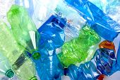 stock photo of discard  - crushed multicolored plastic bottles ready to recycled - JPG