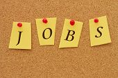 pic of kidnapped  - Jobs board Four yellow notes on a cork board with the word Jobs - JPG