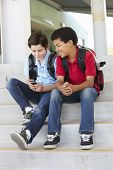 stock photo of pre-teen boy  - Pre teen boys with phone at school - JPG