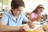 stock photo of pre-teen boy  - Pre teen children in art class - JPG