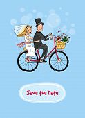 stock photo of bridal veil  - Bride and groom riding on a bicycle in a wedding gown and veil and top hat with the text  - JPG