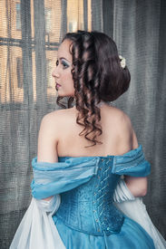foto of pompous  - Portrait of young beautiful medieval woman in blue dress - JPG