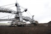 image of collier  - Large excavator digging coal at surface coal mine - JPG