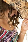 image of cowgirls  - A cowgirl looking down touching the brim of her hat - JPG