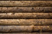 pic of log fence  - Wooden wall from logs as a background texture - JPG
