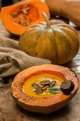 foto of hollow  - Cream of pumpkin soup with pumpkin seeds and and garlic croutons  in hollowed - JPG