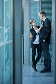 image of office romance  - Young handsome man having a romance with young pretty co - JPG