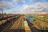 pic of boxcar  - Freight train with color cargo containers passing railway station - JPG