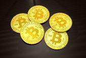 image of bitcoin  - Five golden Bitcoins on a dark background - JPG