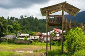 stock photo of mud-hut  - Traditional village in the remote Mamasa Valley West Tana Toraja South Sulawesi Indonesia - JPG