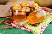 pic of cider apples  - Composition of apple cider with cinnamon sticks - JPG