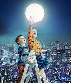 image of reach the stars  - Two young boys reaching stars - JPG