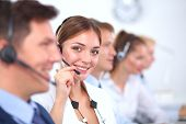 foto of telemarketing  - Attractive  positive young businesspeople and colleagues in a call center office - JPG