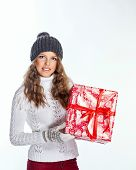 pic of knitted cap  - Cute teen girl in a knitted cap and sweater holds in her hands Christmas gifts - JPG